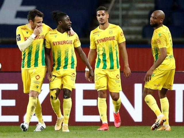Nantes' Moses Simon celebrates scoring their second goal with teammates including Ludovic Blas on March 14, 2021