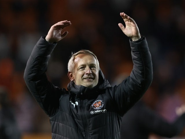 Blackpool's manager Neil Critchley celebrates after the match against Oxford on May 21, 2021