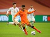 Netherlands' Owen Wijndal in action with Spain's Gerard Moreno in November 2020