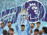 Manchester City's Ruben Dias celebrates with the trophy after winning the Premier League on May 23, 2021