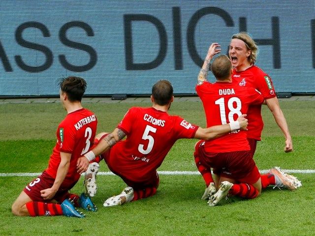 FC Koln's Sebastiaan Bornauw celebrates scoring their first goal with teammates on May 22, 2021