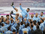 Manchester City's Sergio Aguero is thrown in the air by teammates as they celebrate winning the Premier League after his last match at the Etihad Stadium as a Manchester City player on May 23, 2021