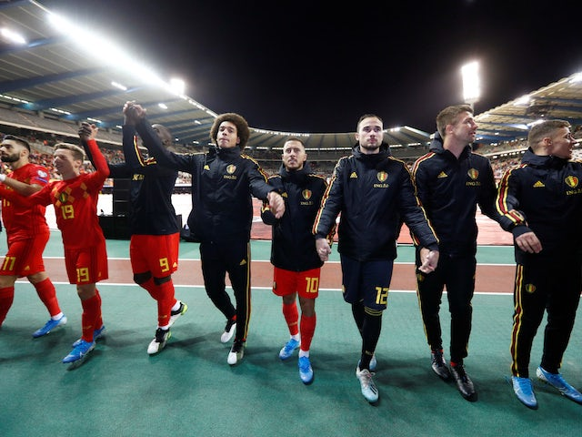 Belgium players celebrate in front of fans after qualifying for Euro 2020 in October 2019