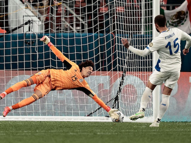Mexico goalkeeper Guillermo Ochoa (13) is unable to make a save on a penalty kick from Costa Rica defender Francisco Calvo (15) during the semifinals of the 2021 CONCACAF Nations League soccer series at Empower Field at Mile High on June 4, 2021