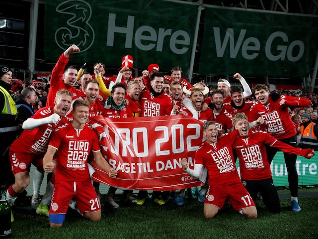 Denmark players pose for a photograph as the celebrate in front of their fans after the match in November 2019