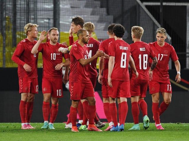 Denmark's Yussuf Poulsen celebrates scoring their first goal with teammates on June 2, 2021