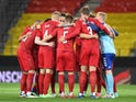 Denmark players huddle before the match on June 2, 2021