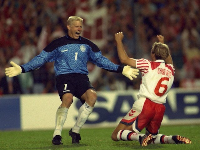 Denmark's Peter Schmeichel and Kim Christofte celebrate at Euro 1992 on June 22, 1992