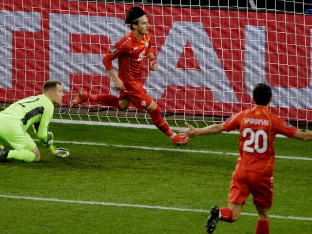 North Macedonia's Eljif Elmas celebrates scoring their second goal against Germany on March 31, 2021