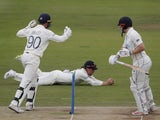 England's Rory Burns takes a catch to dismiss New Zealand's Henry Nicholls on June 6, 2021