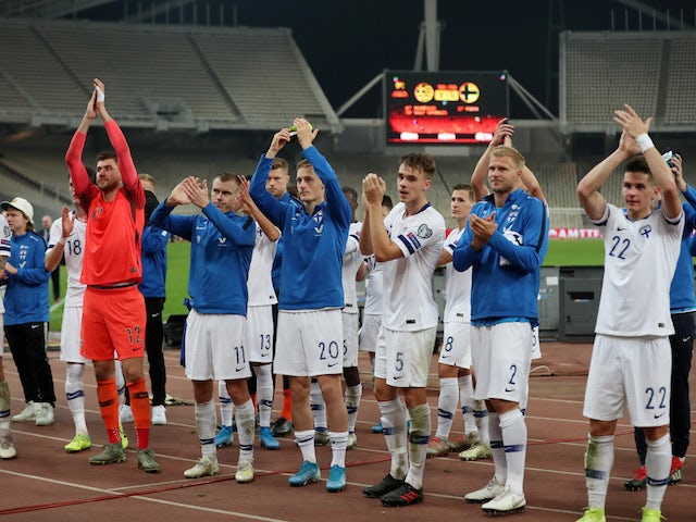 Finland players celebrate qualifying for Euro 2020 in November 2019