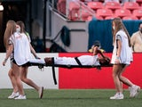 Honduras midfielder Rigoberto Rivas (11) is taken off on a stretcher in the second half against the United States during the semifinals of the 2021 CONCACAF Nations League soccer series at Empower Field at Mile High on June 4, 2021