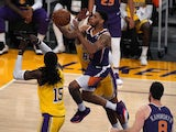 Phoenix Suns guard Cameron Payne is defended by Los Angeles Lakers forward Markieff Morris on June 4, 2021