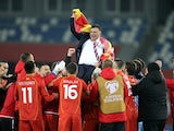 North Macedonia coach Igor Angelovski celebrates with players after qualifying for Euro 2020 in November 2020