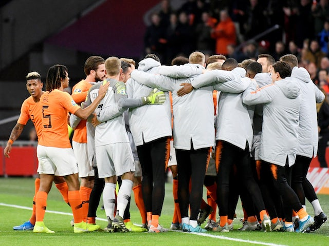 Netherlands' Georginio Wijnaldum scores their first goal with teammates en route to qualification for Euro 2020