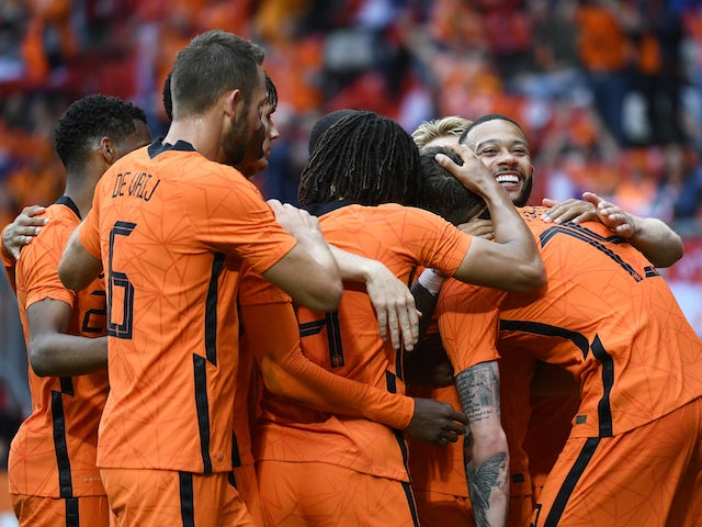 Netherlands' Wout Weghorst celebrates scoring their second goal with teammates on June 6, 2021