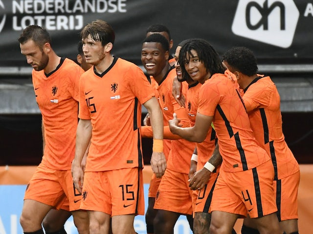 Netherlands' Ryan Gravenberch celebrates scoring their third goal with teammates on June 6, 2021