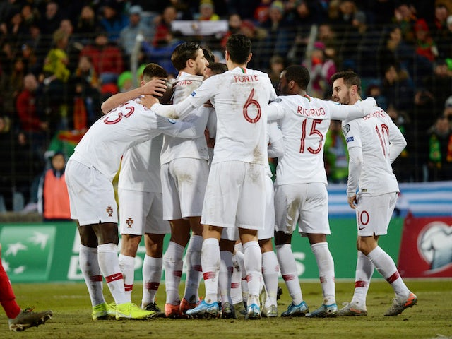Portugal players celebrate scoring in the match that secured their place at Euro 2020, in November 2019