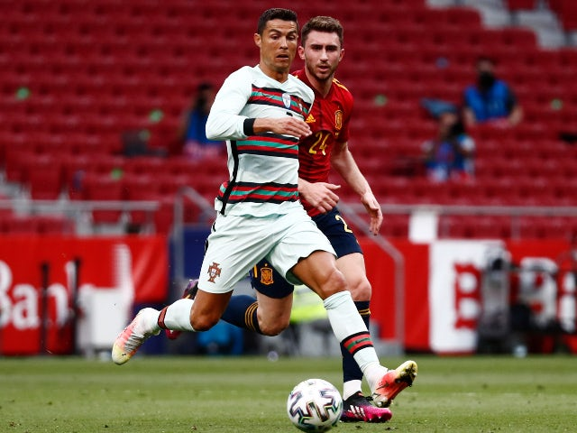 Spain's Aymeric Laporte in action with Portugal's Cristiano Ronaldo on June 4, 2021