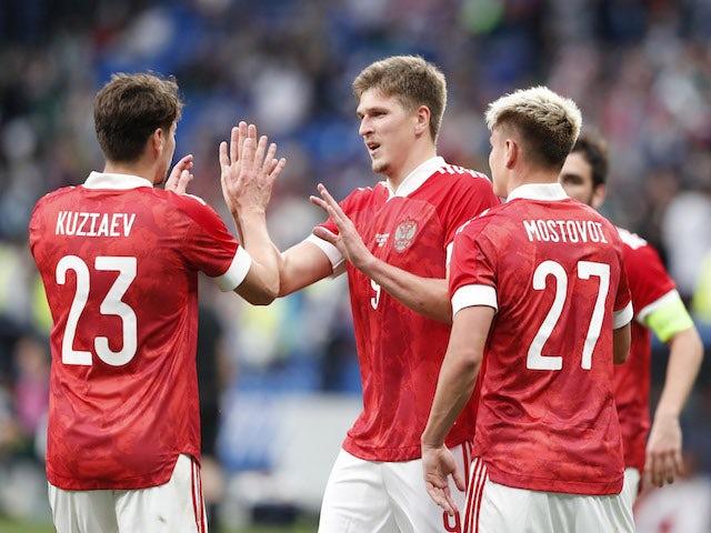 Russia's Aleksandr Sobolev celebrates scoring their first goal with teammates on June 5, 2021