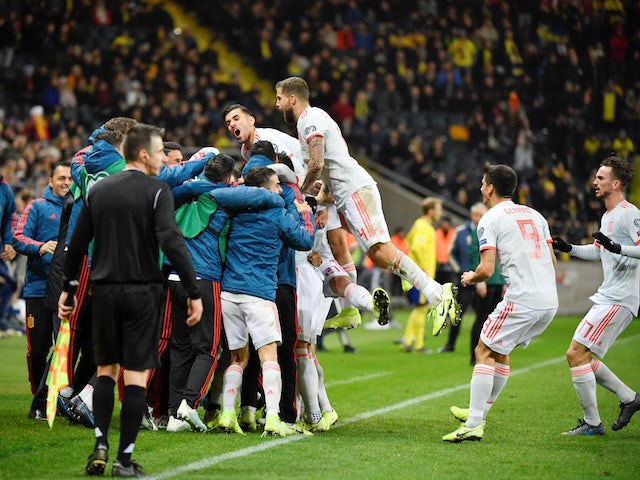 Spain players celebrate scoring against Sweden in October 2019