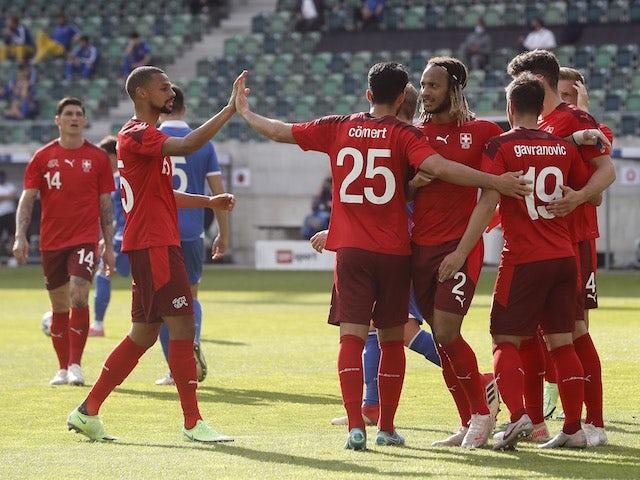 Switzerland's Mario Gavranovic celebrates scoring their first goal with teammates on June 3, 2021