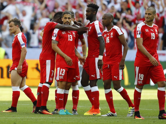 Switzerland players react after losing a penalty shootout to Poland at Euro 2016 on June 25, 2016