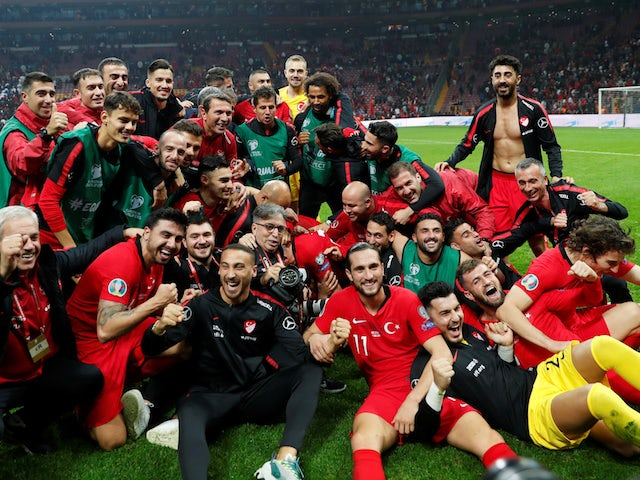 Turkey players celebrate qualifying for Euro 2020 in November 2019