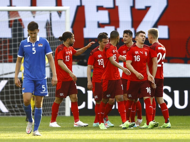 Switzerland's team celebrates scoring their third goal on June 3, 2021