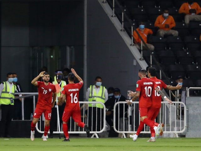 Afghanistan's Omid Popalzay celebrates scoring their first goal with teammates on June 11, 2021