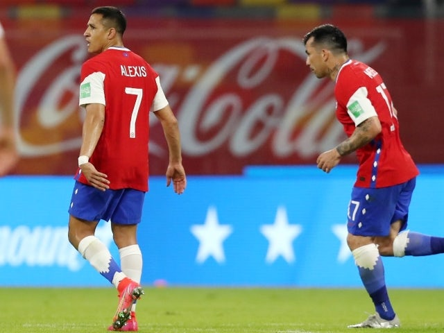 Chile's Alexis Sanchez celebrates scoring their first goal with Gary Medel on June 4, 2021