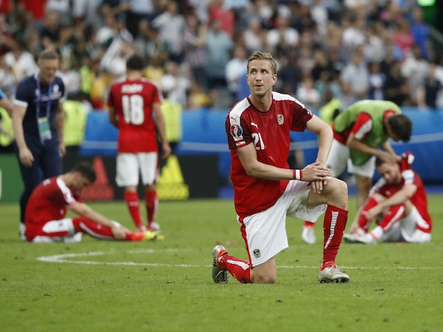 Austria players look dejected after being knocked out of Euro 2016