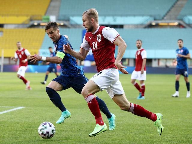 Austria's Konrad Laimer in action with Slovakia's Peter Pekarik on June 6, 2021