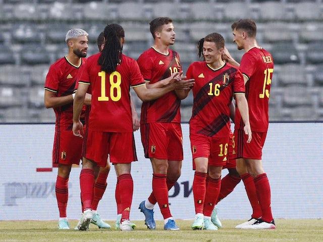 Belgium players celebrate scoring against Greece on June 3, 2021