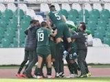Bolivia's Marcelo Moreno celebrates scoring their first goal with teammates on October 13, 2021