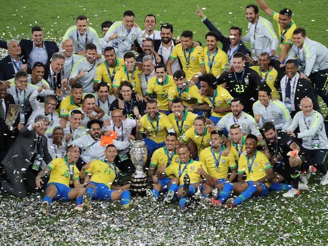 Brazil players celebrate winning the 2019 Copa America