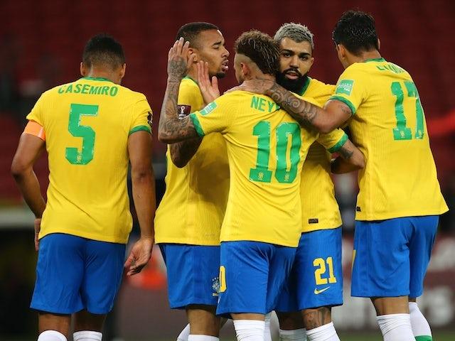 Brazil players celebrate scoring on June 5, 2021
