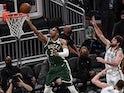 Milwaukee Bucks forward Giannis Antetokounmpo scores a basket past Brooklyn Nets forward Joe Harris on June 11, 2021