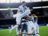 Argentina's Leandro Paredes celebrates scoring their second goal with teammates on June 8, 2021