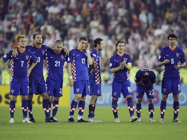 Croatia players look dejected after being knocked out of Euro 2008
