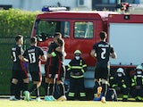 Croatia's Ivan Perisic celebrates scoring their first goal with teammates in front of a fire engine and crew on June 1, 2021
