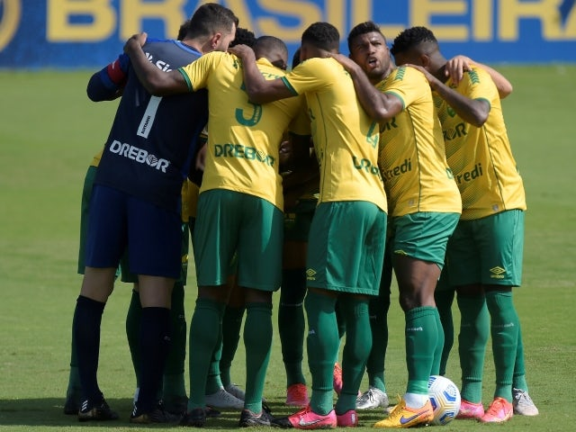 Cuiaba players huddle before the match on June 6, 2021