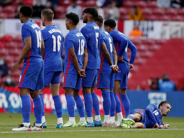 England's Jack Grealish lays down behind the wall to defend a free kick on June 6, 2021
