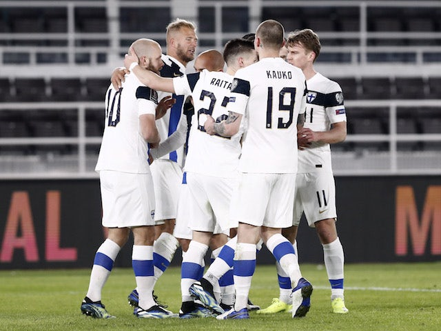 Finland players celebrate scoring against Bosnia on March 24, 2021