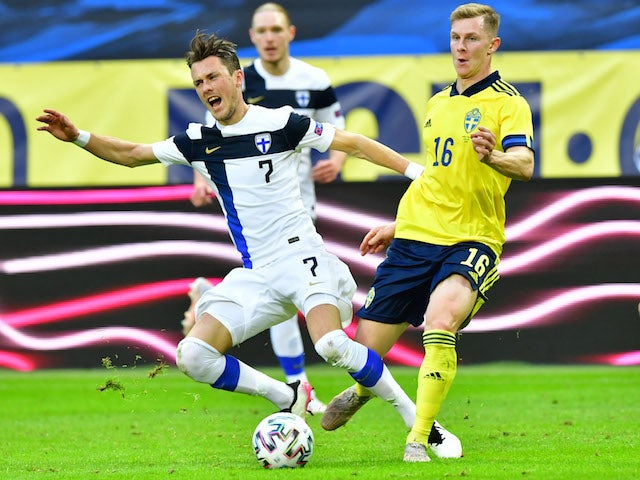 Finland's Thomas Lam in action with Sweden's Emil Krafth on May 29, 2021