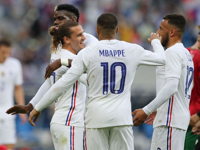 France's Antoine Griezmann celebrates scoring their first goal with teammates on June 8, 2021