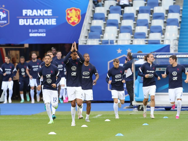 France's players warm up ahead of their game against Bulgaria on June 8, 2021