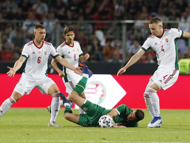 Hungary's Willi Orban and Attila Szalai in action with Republic of Ireland Troy Parrott on June 8, 2021