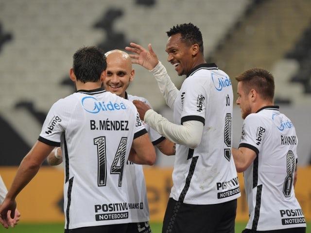Corinthians' Jo celebrates scoring their second goal with teammates on May 27, 2021