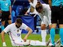 France's Karim Benzema down injured as Antoine Griezmann looks on, on June 8, 2021